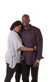 Middle aged couple with their arms around each other Royalty Free Stock Image