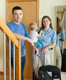 Middle-aged couple with toddler with suitcases Royalty Free Stock Photos