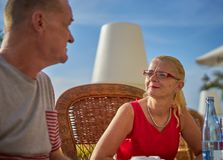 Middle Aged Couple Together on Seafront Terrace Stock Photo