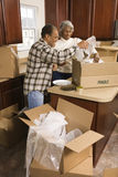Middle-aged couple unpacking boxes. Royalty Free Stock Photos