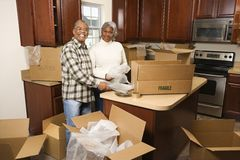 Middle-aged couple unpacking boxes. Royalty Free Stock Images