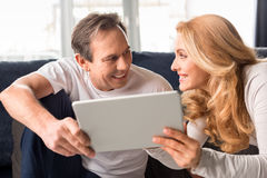 Middle aged couple using digital tablet at home Stock Photos