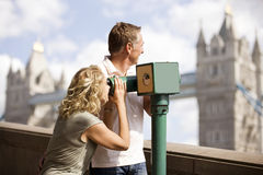 A middle-aged couple using a telescope Stock Image