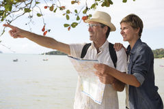 Middle aged couple on vacation with map Royalty Free Stock Photos