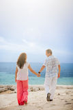 Middle Aged Couple Walking on the Beach Royalty Free Stock Photography