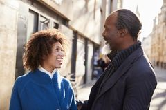 Middle Aged Couple Walking Through City In Fall Together royalty free stock photography