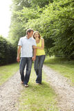 Middle aged couple walking in countryside royalty free stock images