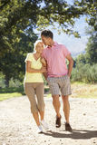 Middle Aged Couple Walking Through Countryside Stock Photos
