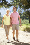 Middle Aged Couple Walking Through Countryside Royalty Free Stock Images