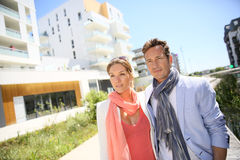 Middle-aged couple walking in new residential area Stock Images