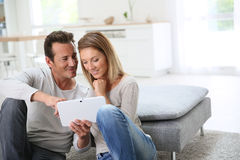Middle-aged couple websurfing with tablet Stock Image