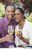 Middle Aged Couple With Wine Glasses Outdoors Stock Photo