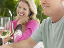 Middle Aged Couple With Wine At Outdoor Table Stock Photography