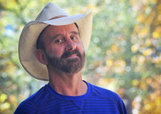 A Middle Aged Cowboy with Autumn Leaves Behind Royalty Free Stock Photography