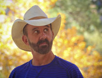 A Middle Aged Cowboy with Autumn Leaves Behind Stock Photography
