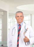 Middle Aged Doctor with Clipboard Royalty Free Stock Images