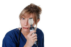 Middle aged doctor doing an eye exam royalty free stock image