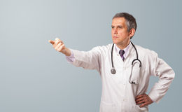 Middle aged doctor gesturing with copy space Royalty Free Stock Photos