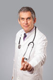 Middle aged doctor gesturing with copy space Royalty Free Stock Image