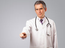 Middle aged doctor gesturing with copy space Royalty Free Stock Photo