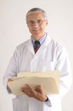 Middle aged Doctor Holding Folder Patients Chart Royalty Free Stock Image