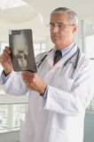 Middle Aged Doctor in Lab Coat with X-ray Stock Photos