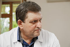 Middle-aged doctor looking sideways Royalty Free Stock Image