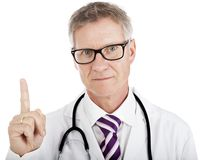 Middle-aged doctor pointing above his head Stock Photos