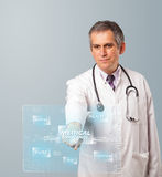 Middle aged doctor pressing modern medical type of button Stock Photos