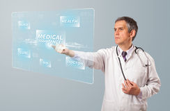 Middle aged doctor pressing modern medical type of button Stock Image