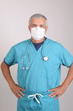 Middle aged Doctor in Scrubs with Hands on Hips Stock Photography