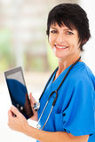Middle aged doctor tablet Stock Photography