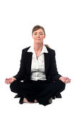 Middle aged doing meditation, lotus pose Stock Image