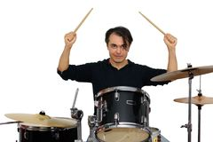 Middle aged drummer with drumsticks in his hands playing drum se Stock Images
