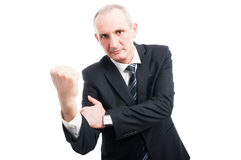 Middle aged elegant man showing obscene gesture. Wearing suit and tie isolated on white background with copy text space Royalty Free Stock Photo