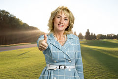Middle aged elegant woman raised thumb up. royalty free stock photo