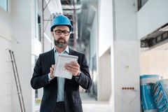 Middle-aged engineer in hardhat stock photo