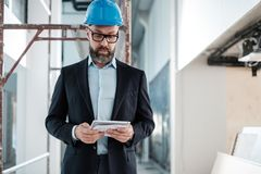Middle-aged engineer in hardhat royalty free stock photos