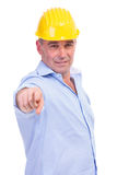 Middle aged engineer pointing at you Stock Photo