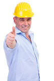 Middle aged engineer showing thumbs up Stock Images