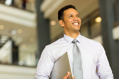 Middle aged entrepreneur. Good looking middle aged entrepreneur in office building Royalty Free Stock Photo