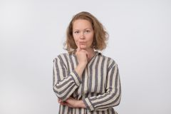 Middle aged european woman thinking and looking up, confused about an ide royalty free stock photo