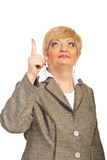 Middle Aged Executive Woman Pointing Up Stock Photos