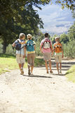 Middle Aged Family Hiking Through Countryside Royalty Free Stock Photos