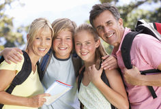 Middle Aged Family Hiking Through Countryside Royalty Free Stock Images