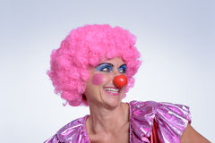 Middle Aged Female Clown Smiling Into the Distance Stock Image