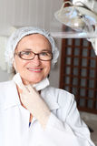 Middle aged female dentist Royalty Free Stock Image