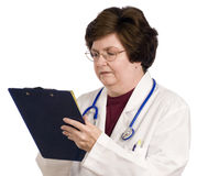 Middle-aged Female Doctor With Clipboard Stock Image