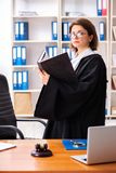 The middle-aged female lawyer working in courthouse. Middle-aged female lawyer working in courthouse royalty free stock photography