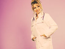 Middle aged female medical doctor. Female medical doctor in white professional uniform apron with blue stethoscope on her neck. Middle aged woman pharmacist Stock Photo